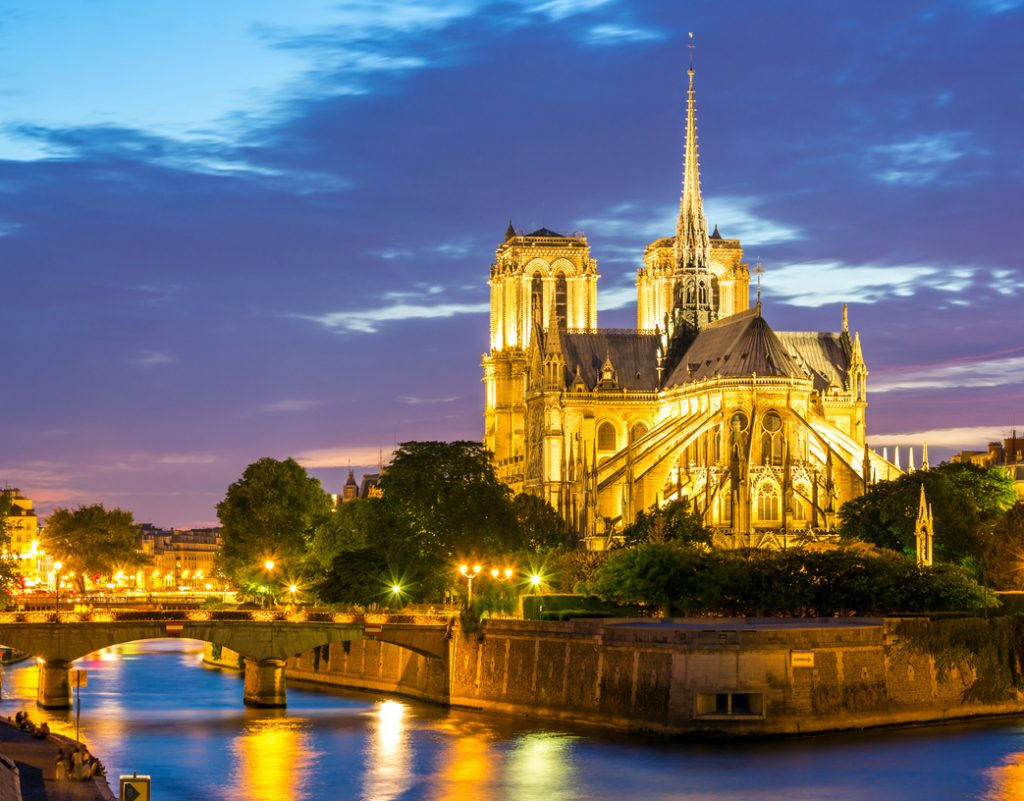 notre-dame de paris from behind on the river